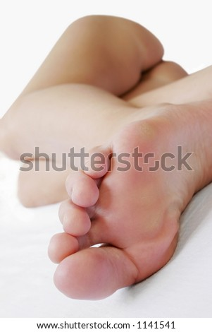Woman asleep in bed from a foot point of view