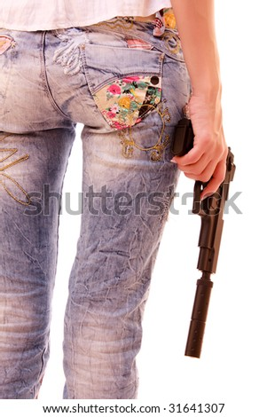 Woman ass and pistol in hands isolated on white - stock photo