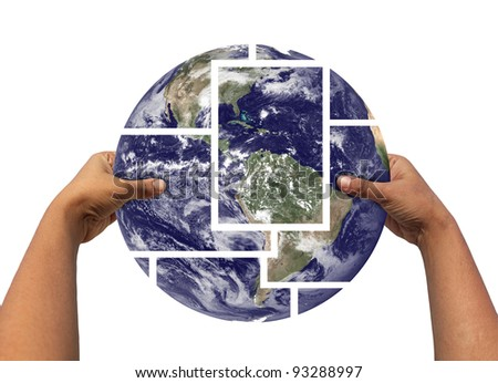 Woman assembling and holding earth photos partitioned and then joined again. Concept of saving earth. Earth photo credit - http://www.nasa.gov - stock photo