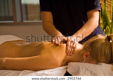 woman at a day spa getting a massage - stock photo