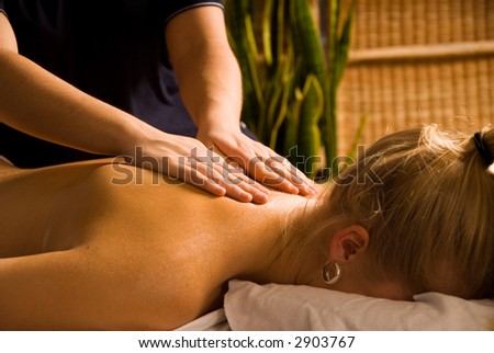 woman at a day spa getting a nice massage - stock photo