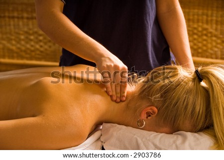 woman at a day spa getting a nice neck massage - stock photo