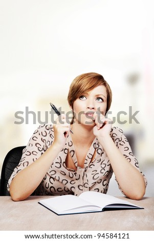 woman at a desk deep in thought