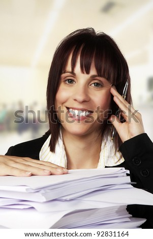 woman at a desk with a lot of paper work to get through