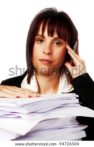woman at a desk with a lot of paper work to get through - stock photo