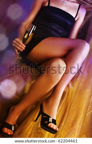 Woman at a party in night club - stock photo