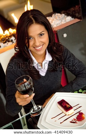 Woman at a restaurant having a glass of wine - stock photo