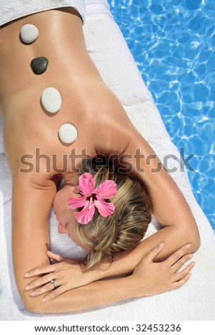 Woman at a spa with white stone on her forehead - stock photo