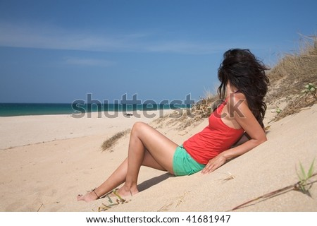 woman at beach of palmar in cadiz spain