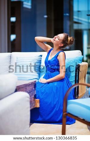 woman at beautiful interior outdoors at hotel lobby - stock photo