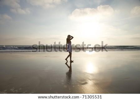 woman at Castilnovo Beach in Cadiz Andalusia Spain - stock photo
