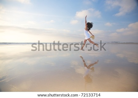 woman at Castilnovo Beach in Cadiz Andalusia Spain - stock photo
