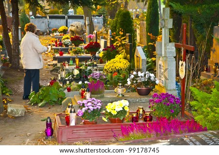 Woman at cemetery, All Saints Day, Wroclaw, Poland - stock photo