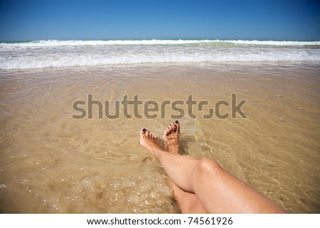 woman at Conil Beach in Cadiz Andalusia Spain - stock photo