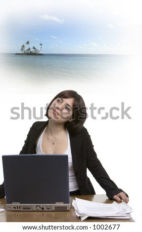 Woman at her desk dreaming of vacation - stock photo