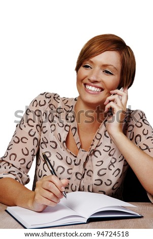 woman at her desk on the phone - stock photo