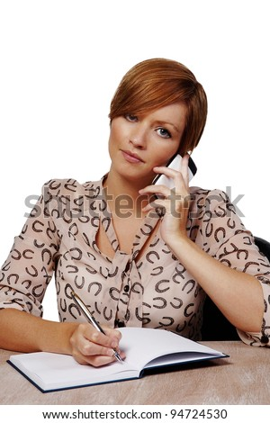 woman at her desk on the phone