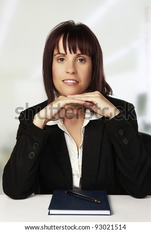 woman at her desk thinking about?