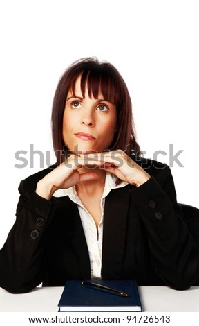 woman at her desk thinking about? - stock photo