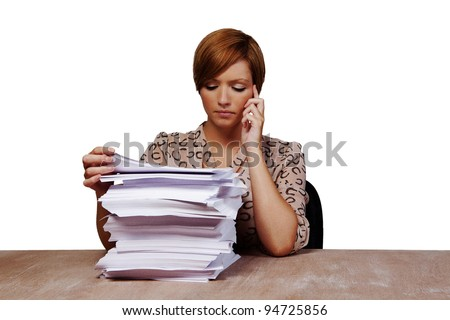 woman at her desk with lots of paper work to do