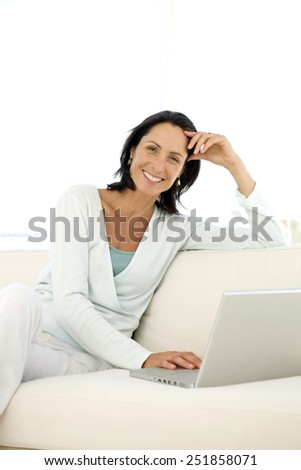 Woman at home with laptop - portrait