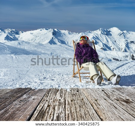 Woman at mountains in Santa hat celebrating christmas, Meribel, Alps, France - stock photo