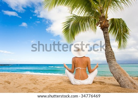 woman at peace in white outfit on tropical beach