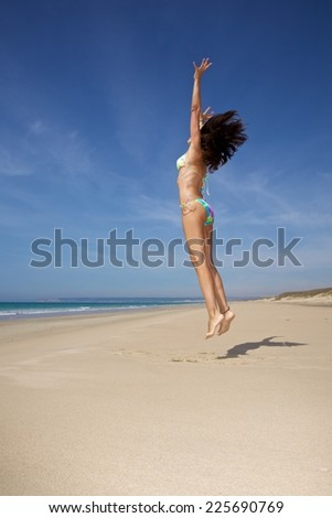 woman at sandy beach in Cadiz Andalusia Spain - stock photo