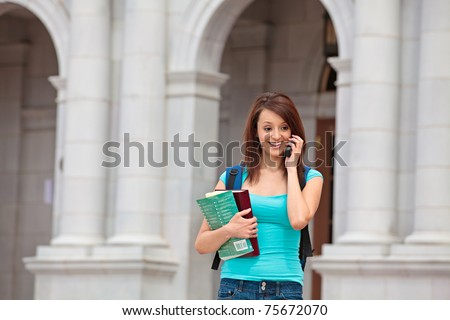 Woman at school talking on cell phone - stock photo