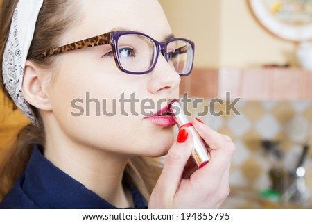 Woman at sexy suit stains pink upper lip - stock photo