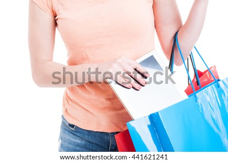 Woman at shopping holding shopping bags with  tablet or gadget concept isolated on white background