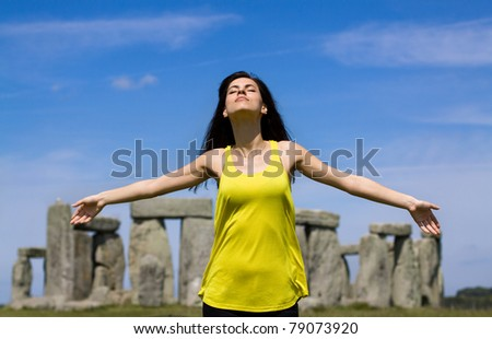 Woman at Stonehenge (England). Person enjoy famous Place Stonehenge (England, UK). Summer time - stock photo