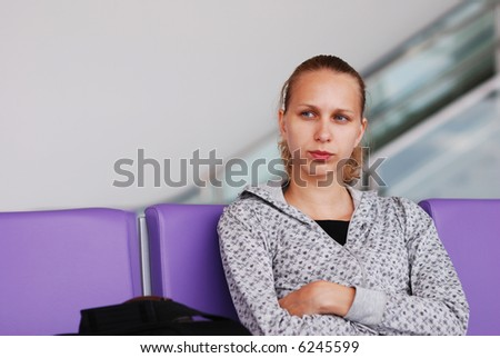 Woman at the airport, shallow DOF - stock photo