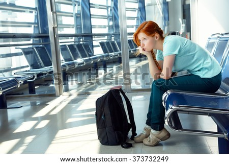 woman at the airport. waiting hall. flight delay - stock photo