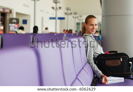 Woman at the airport with tickets, shallow DOF - stock photo
