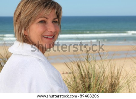 Woman at the beach - stock photo