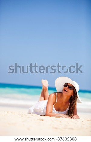 Woman at the beach enjoying her vacations in paradise