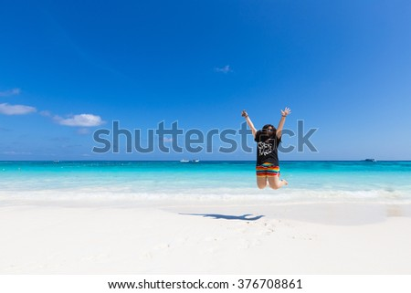 Woman at the beach in summer. Sea in the beautiful and the weather is hot. - stock photo
