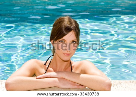 Woman at the Edge of a Swimming Pool - stock photo