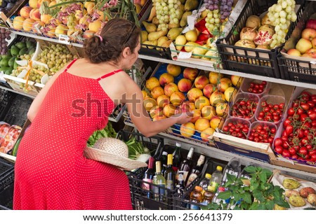 Woman at the fruit stand - stock photo