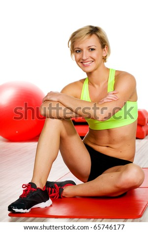 Woman at the gym - stock photo
