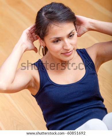 Woman at the gym doing exercises for her abs - stock photo