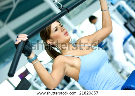 woman at the gym exercising on a machine