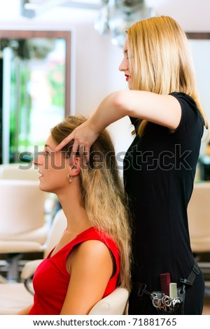 Woman at the hairdresser getting a head massage in the salon - stock photo
