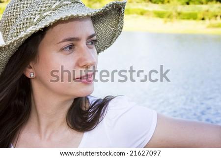 Woman at the lake - stock photo