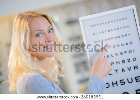 Woman at the opticians - stock photo