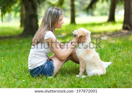 Woman at the park with her dog