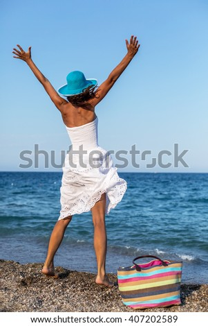 Woman at the seaside. - stock photo
