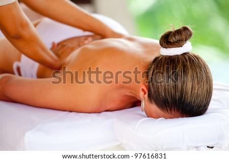 Woman at the spa getting a back massage - stock photo
