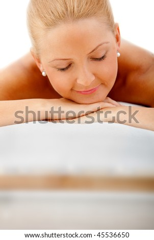 Woman at the spa relaxed isolated on white - stock photo